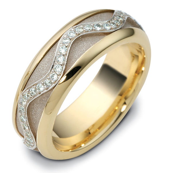 Item # 47769E - 18kt Two-tone gold diamond, comfort fit, spinning, 7.0mm wide wedding band. The ring has approximately 0.30 ct tw diamonds, VS1-2 in clarity and G-H in color. There are about 60 round brilliant cut diamonds all around the band. The quantity and total weight of diamonds may vary depending on the size of the ring. The center of the ring spins. It is 7.0mm wide and comfort fit. The center of the band has a sandblast finish.