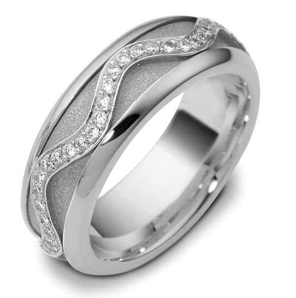 Item # 47769W - 14kt White gold diamond, comfort fit, spinning, 7.0mm wide wedding band. The ring has approximately 0.30 ct tw diamonds, VS1-2 in clarity and G-H in color. There are about 60 round brilliant cut diamonds all around the band. The quantity and total weight of diamonds may vary depending on the size of the ring. The center of the ring spins. It is 7.0mm wide and comfort fit. The center of the band has a sandblast finish.