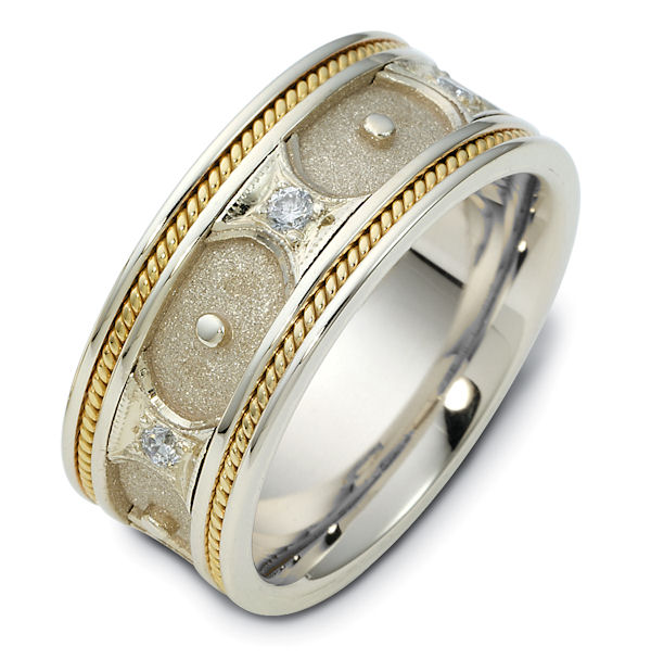 Item # 47905E - 18kt Two-tone gold hand crafted, comfort fit, 8.5mm wide wedding band. The ring has 0.09 ct tw diamonds, VS1-2 in clarity and G-H in color. It holds 6 round brilliant cut diamonds weighing about 0.015 ct each. The ring has a mixture of sandblast and polish finish.