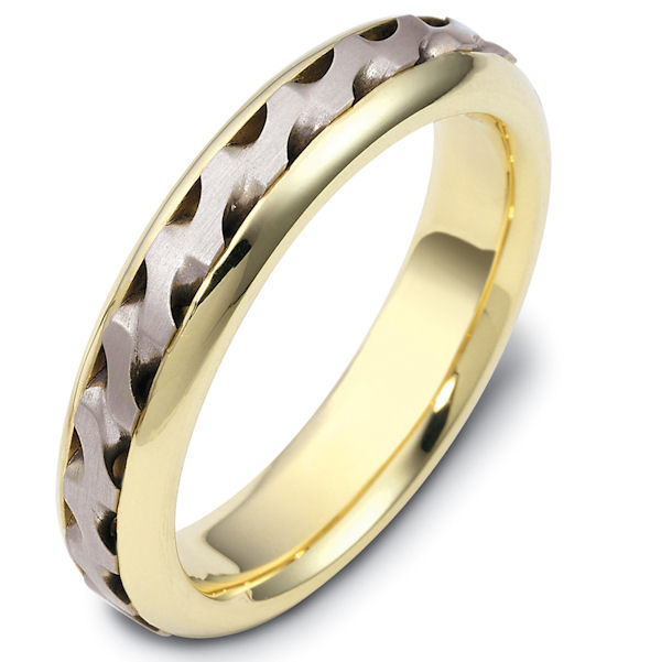 Item # 47922E - 18kt Two-tone gold handcrafted, comfort fit, 5.0mm wide wedding band. There is a beautiful carved and crafted patter in the center of the band that has a matte finish. The edges are polished finish. Different finishes may be selected or specified.