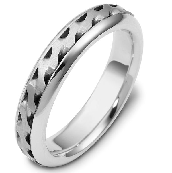 Item # 47922WE - 18kt White gold handcrafted, comfort fit, 5.0mm wide wedding band. There is a beautiful carved and crafted patter in the center of the band that has a matte finish. The edges are polished finish. Different finishes may be selected or specified.