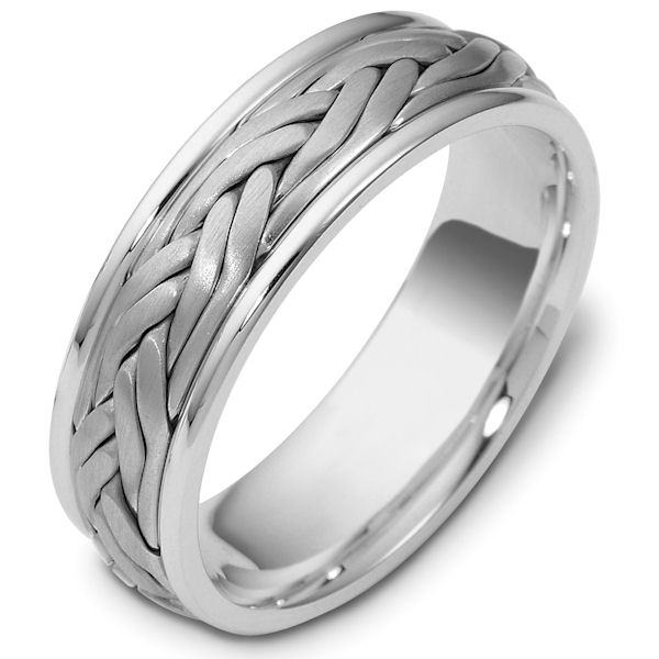Item # 47923WE - 18kt White gold handcrafted, comfort fit, 7.0mm wide wedding band. The ring has a beautiful hand crafted braid in the center that has a matte finish. The edges are polished. Different finishes may be selected or specified.