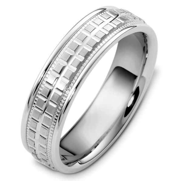 Item # 48049W - 14kt White gold contemporary, comfort fit, 6.0mm wide wedding band. The ring has a carved pattern around the whole band. It is a polished finish. Different finishes may be selected or specified.