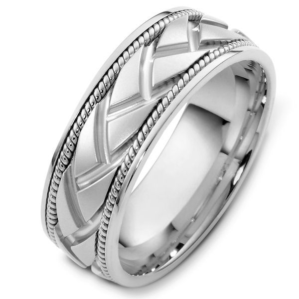 Item # 48237NW - 14kt White gold handcrafted, carved, comfort fit, 8.0mm wide wedding band. The center of the ring is carved and one hand crafted rope on each side of the carving. It is 8.0mm wide and comfort fit.