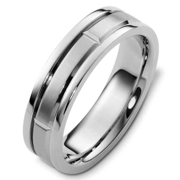 Item # 48238W - 14kt White gold carved classic, comfort fit, 6.0mm wide wedding band. The matte center of the ring has a continuous carved pattern and polish finish on the edges. Different finishes may be selected or specified.