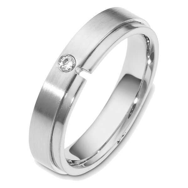 Item # 48549WE - 18kt White gold diamond, comfort fit, 5.0mm wide wedding band. The ring holds one round brilliant cut diamond that is 0.05 ct, VS1-2 in clarity and G-H in color. The portion with the diamond is matte finish and the rest is polished. Different finishes may be selected.