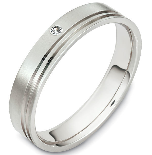 Item # 48606PD - Palladium diamond, comfort fit, 4.5mm wide wedding band. The ring holds one round brilliant cut diamond that is 0.02 ct, VS1-2 in clarity and G-H in color. There are 2 carved lines around the whole band. It is 4.5mm wide, comfort fit, and has a matte finish. Different finishes may be selected.