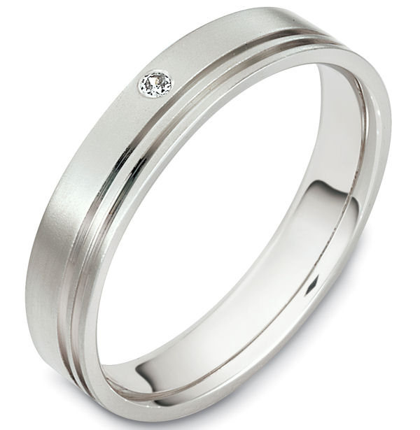 Item # 48606W - 14kt White gold diamond, comfort fit, 4.5mm wide wedding band. The ring holds one round brilliant cut diamond that is 0.02 ct, VS1-2 in clarity and G-H in color. There are 2 carved lines around the whole band. It is 4.5mm wide, comfort fit, and has a matte finish. Different finishes may be selected.