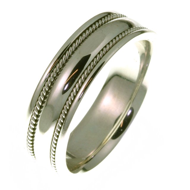 Item # 49012W - 14kt White gold handcrafted, comfort fit, 7.0mm wide wedding band. The ring has a beautiful design with a handcrafted rope on each side. The ring has a polished finish. Different finishes may be selected or specified.