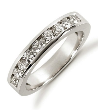 Item # 521249W - 14Kt White gold anniversary band. The ring holds 9 round brilliant cut diamonds each measures 2.7 mm in size. The diamonds are approximately 0.63 ct tw, VS1-2 in clarity, very clean and G-H in color, near colorless to colorless. The diamonds are channel set. The band is about 3.5 mm wide. The finish is polished. Different finishes may be selected or specified.