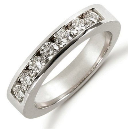 Item # 521257PD - Palladium anniversary band. The ring holds 7 round brilliant cut diamonds each measures 3.0 mm in size. The diamonds are approximately 0.70 ct tw, VS1-2 in clarity, very clean and G-H in color, near colorless to colorless. The diamonds are channel set. The band is about 4.0 mm wide. The finish is polished. Different finishes may be selected or specified.