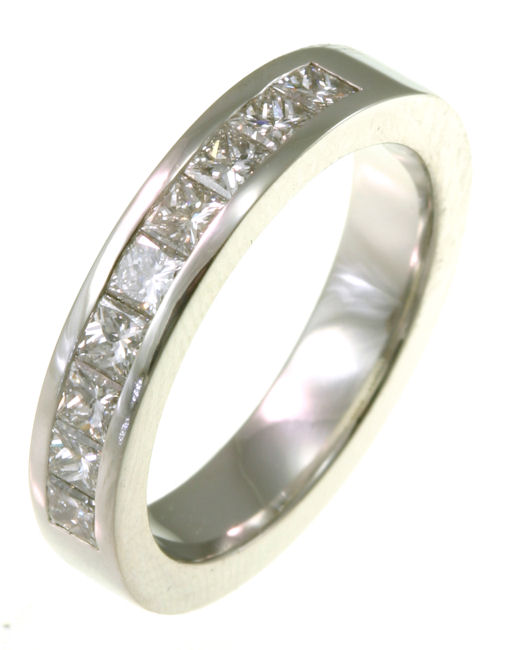Item # 521409W - 14Kt White gold anniversary band. The ring holds 9 princess cut diamonds each measures 2.5x2.5 mm in size. The diamonds are approximately 0.90 ct tw, VS1-2 in clarity, very clean and G-H in color, near colorless to colorless. The diamonds are set in a channel. The band is about 3.5 mm wide. The finish is polished. Different finishes may be selected or specified.