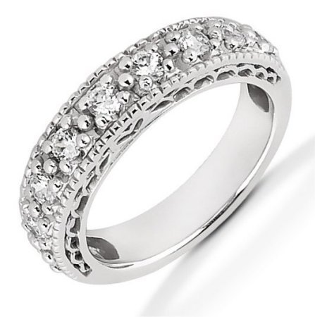 Item # 521453W - 14Kt White gold anniversary band. The ring holds 9 round brilliant cut diamonds that measures 2.7 mm in size. The diamonds are approximately 0.63 ct tw, VS1-2 in clarity, very clean and G-H in color, near colorless to colorless. The diamonds are set in prongs. The band is about 4.0 mm wide. The finish is polished. Different finishes may be selected or specified.