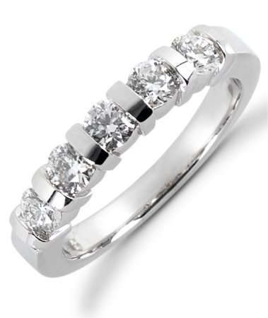 Item # 522985W - 14Kt White gold anniversary band. The ring holds 5 round brilliant cut diamonds, each measures 3.4 mm. The diamonds are approximately 0.75 ct tw, VS1-2 in clarity, very clean and G-H in color.  The diamonds are set in single channels. The band is about 3.5 mm wide. The finish is polished. Different finishes may be selected.