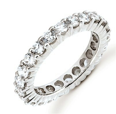 Item # 5310010WE - 18Kt White gold eternity ring. The ring holds 34 round brilliant cut diamonds, each measures 1.5 mm. The diamonds are approximately 0.51 ct tw for size 6.0, VS1-2 in clarity, very clean and G-H in color, near colorless to colorless. The diamonds are set in prongs.  The band is about 2.0mm wide. The finish is polished. Different finishes may be selected.