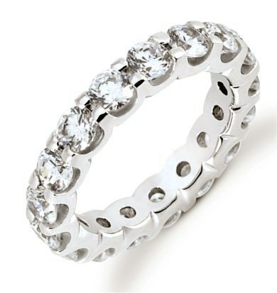 Item # 5316720PP - Platinum eternity ring. The ring holds 16 round brilliant cut diamonds, each measures 3.8 mm. The diamonds are approximately 3.20 ct tw, VS1-2 in clarity, very clean and G-H in color, near colorless to colorless. The diamonds are set in prongs. There may be more diamonds in large size rings. The band is about 4.5 mm wide. The finish is polished. Different finishes may be selected.