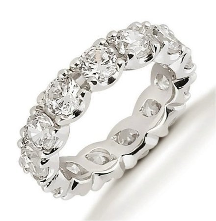 Item # 53306PD - Diamond eternity ring made with palladium. The ring holds 13 round brilliant cut diamonds each measures approximately 4.3 mm in size. The diamonds total weight is approximately 4.0 ct for size 6.0. Diamonds are graded VS1-2 in clarity and G-H in color. The band is about 5.0 mm in width. Each diamond is set in prongs and the diamonds total weight changes with ring size. The finish is polished. Different finishes may be selected.