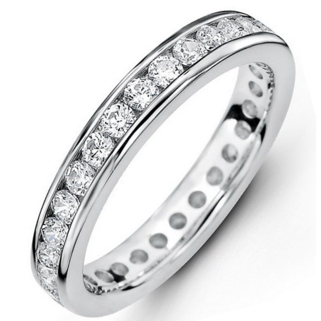 Item # 5342110WE - 18Kt White gold eternity ring. The ring holds 21 round brilliant cut diamonds, each measures 3.0 mm. The diamonds are approximately 2.10 ct tw, VS1-2 in clarity, very clean and G-H in color, near colorless to colorless. The diamonds are channel set. There may be more diamonds in larger ring sizes. The band is about 4.0 mm wide. The finish is polished. Different finishes may be selected.