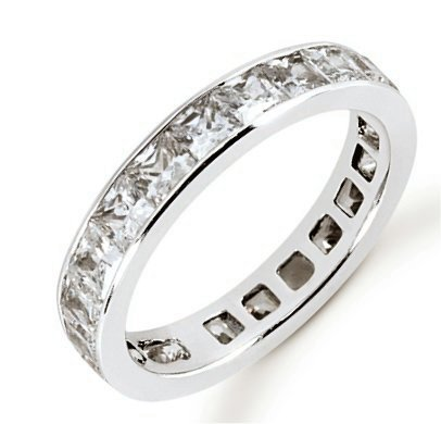 Item # 534223WE - 18Kt White gold eternity ring. The ring holds 21 princess cut diamonds, each measures 3x3 mm. The diamonds are approximately 3.57 ct tw, VS1-2 in clarity, very clean and G-H in color, near colorless to colorless. The diamonds are channel set. There may be more diamonds in larger size rings. The band is about 4.0 mm wide. The finish is polished. Different finishes may be selected.