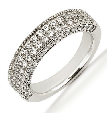 Item # 5410489W - 14Kt White gold anniversary band. The ring holds 70 round brilliant cut diamonds, each measures 1.5 mm. The diamonds are approximately 1.05 ct tw, VS1-2 in clarity, very clean and G-H in color, near colorless to colorless. The diamonds are set with prongs and both in the center with two rows of diamonds and a single row of diamonds on the side of the band. The band is about 4.5 mm wide. The finish is polished. Different finishes may be selected.