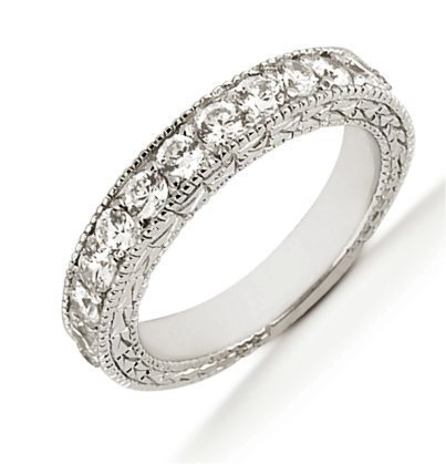 Item # 543959PP - Platinum anniversary band. The ring holds 11 round brilliant cut diamonds, each measures 1.8 mm. The diamonds are approximately 0.28 ct tw, VS1-2 in clarity, very clean and G-H in color, near colorless to colorless. The ring has a carved design and the diamonds are set in prongs. The band is about 3.5 mm.