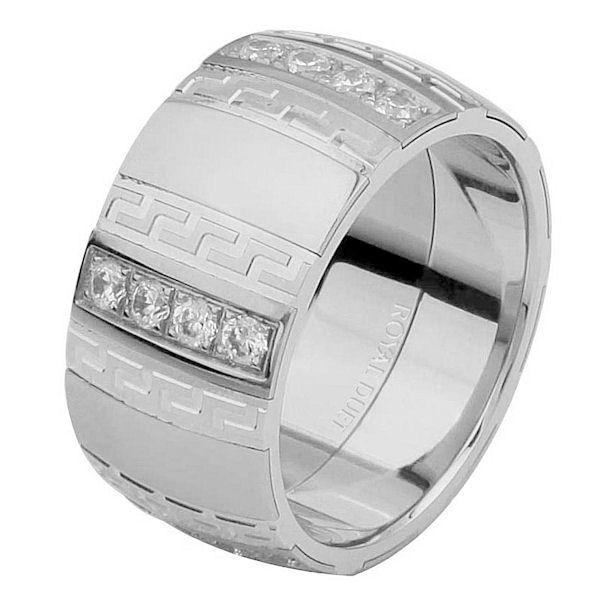 Item # 6871312DW - 14 kt white gold, comfort fit, 10.15 mm wide, diamond wedding ring. The band combines white gold in a unique way with diamonds set into the ring. It has approximately 0.70 ct tw brilliant round cut diamonds, that is VS1-2 in clarity and G-H in color. The diamonds go around the whole band. It has a mixture of matte and polished finishes. Different finishes may be selected or specified.