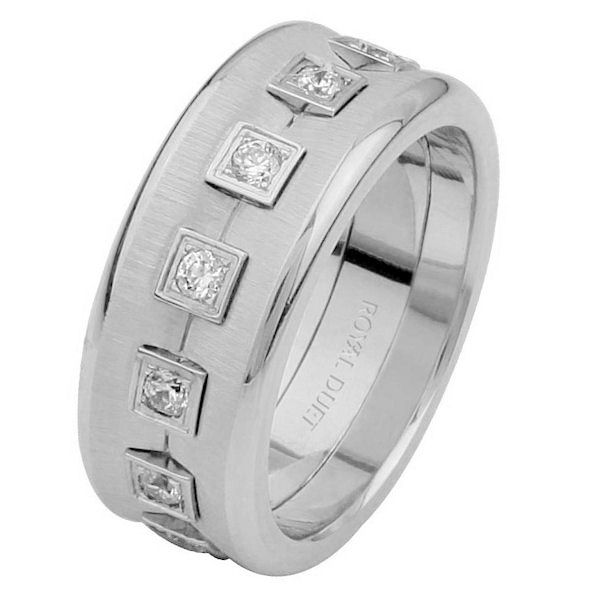 Item # 6871610DWE - 18 kt white gold, comfort fit, 8.20 mm wide, eternity diamond wedding ring. The band is concaved with diamonds set in the center. It has approximately 0.52 ct tw round brilliant cut diamonds, that are VS1-2 in clarity and G-H in color. The ring has a strong brushed finish in the center with polished edges. Different finishes may be selected or specified.