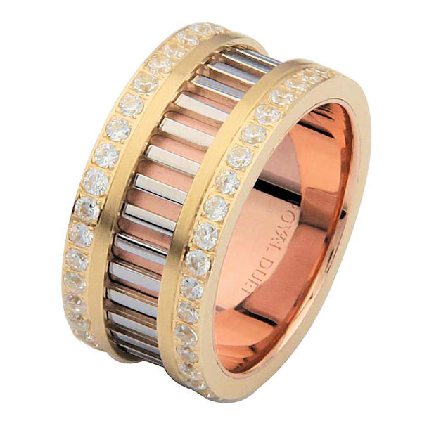 Item # 68719102DE - 18 kt tri-color, comfort fit, 10.0 mm wide, diamond eternity ring. The band combines white, yellow and rose gold in a unique design with diamond rows on each side of the band. The diamonds go around the whole ring. It has approximately 1.20 ct tw brilliant cut diamonds, that are VS1-2 in clarity and G-H in color. The diamond weight may vary depending on the size of the ring.