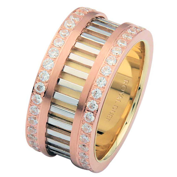 Item # 68719201D - 14 kt tri-color, comfort fit, 10.0 mm wide, diamond eternity ring. The band combines white, yellow and rose gold in a unique design with diamond rows on each side of the band. The diamonds go around the whole ring. It has approximately 1.20 ct tw brilliant cut diamonds, that are VS1-2 in clarity and G-H in color. The diamond weight may vary depending on the size of the ring.