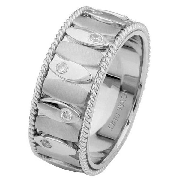 Item # 68720201DW - 14 kt white gold, comfort fit, 8.15 mm wide, diamond wedding ring. The band combines white gold using both crafts of machine and hand made methods. It has approximately 0.24 ct tw round brilliant cut diamonds set around the whole ring, that are VS-1 in clarity and G-H in color.