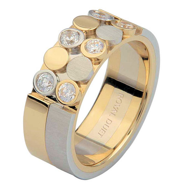 Item # 6872410DE - 18 kt two-tone gold, comfort fit, 7.0 mm wide, diamond wedding ring. The band combines white and yellow gold to create a beautiful design with the diamonds set in the ring. It has approximately 0.42 ct tw round brilliant cut diamonds, that are VS1-2 in clarity and G-H in color. The white gold has a brush finish and the yellow gold has a polished finish. Different finishes may be selected or specified.