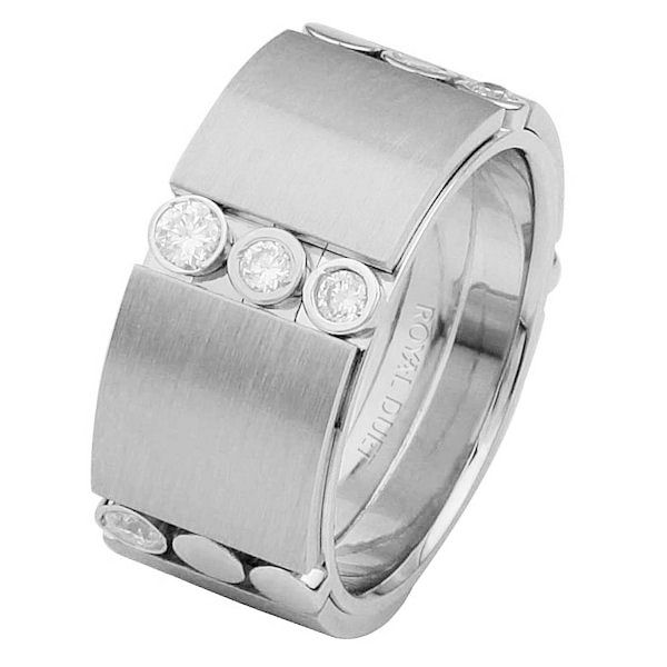 Item # 687272010DW - 14 kt white gold, comfort fit, 9.3 mm wide, diamond wedding ring. The band combines the white gold in a unique way to create a beautiful design with diamonds set into the ring. It has approximately 0.42 ct tw round brilliant cut diamonds, that are VS1-2 in clarity and G-H in color.