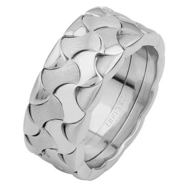 Item # 6872810WE - 18 kt white gold, comfort fit, 8.9 mm wide, wedding ring. The band combines the white gold to create a unique design. It has a mixture of brushed and polished finishes. Different finishes may be selected or specified.