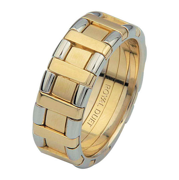 Item # 68735101E - 18 kt two-tone gold, comfort fit, 7.1 mm wide, wedding ring. The band has white and yellow gold combined to create a beautiful design. There is a mixture of brushed and polished finish. Other finishes may be selected or specified.