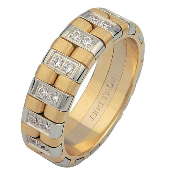 Item # 6873710D - 14 kt two-tone gold, comfort fit, 6.0 mm wide, diamond wedding ring. The band has a white and yellow gold combination to create a beautiful design with diamonds set around the whole ring. It has approximately 0.60 ct tw round brilliant cut diamonds, that are VS1-2 in clarity and G-H in color. There is a mixture of brushed and polished finishes. Other finishes may be selected or specified.