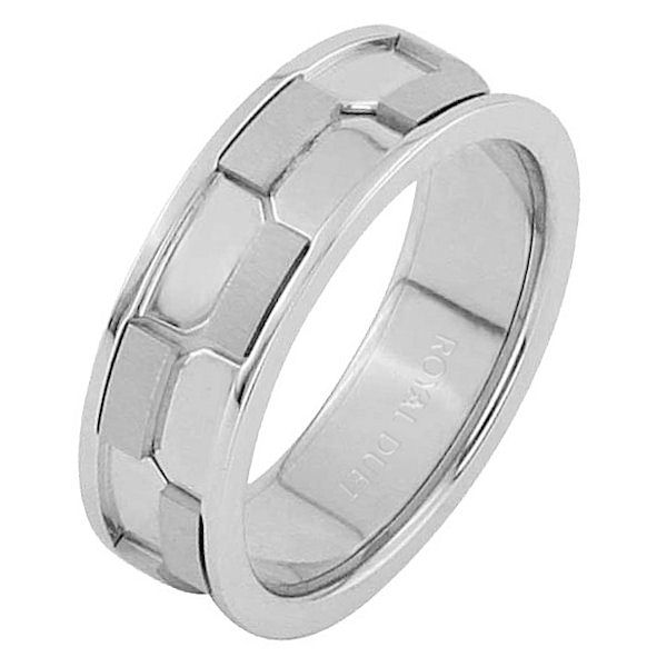 Item # 68740010WE - 18 kt white gold, comfort fit, 7.0 mm wide, wedding ring. The band has a beautiful design with white gold. There is a mixture of brushed and polished finishes. Other finishes may be selected or specified.