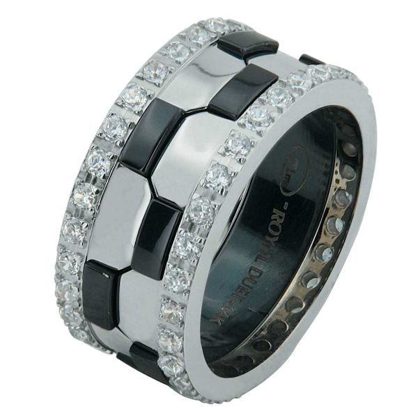 Item # 68740030DWE - 18 kt white gold and black rhodium, comfort fit, 9.3 mm wide, diamond eternity wedding ring. The band has a beautiful design of white gold with black rhodium on the ring. There are diamonds set around the whole ring on each side. It has approximately 1.05 ct tw round brililant cut diamonds, that are VS1-2 in clarity and G-H in color. The total weight of the diamonds may vary depending on the ring size.