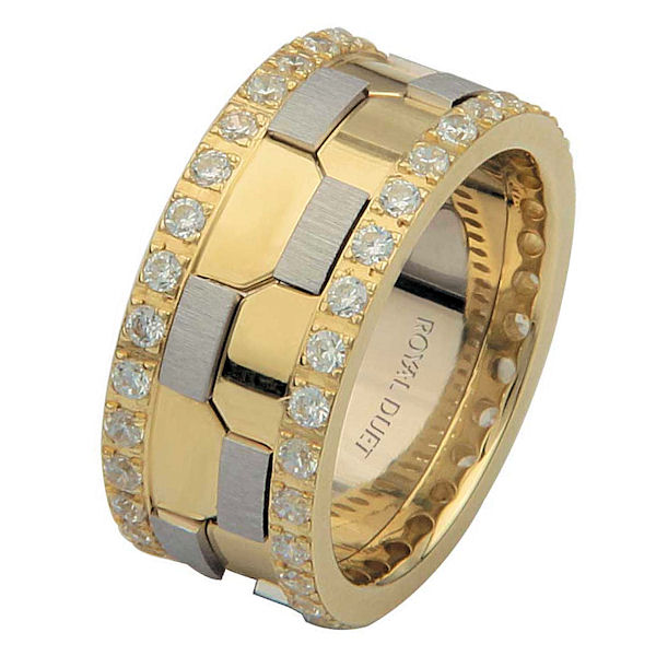 Item # 68740101DE - 18 kt two-tone gold, comfort fit, 9.3 mm wide, diamond eternity wedding ring. The band has a beautiful design with white and yellow gold. There are diamonds set around the whole band on each side. It has approximately 1.05 ct tw round brilliant cut diamonds, that are VS1-2 in clarity and G-H in color. The total weight of diamonds may vary depending on the size of the ring.
