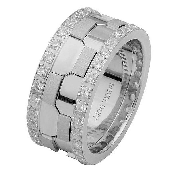 Item # 68740101DWE - 18 kt white gold, comfort fit, 9.3 mm wide, diamond eternity wedding ring. The band has a beautiful design of white gold. There are diamonds around the whole ring set on each side. It has approximately 1.05 ct tw round brilliant cut diamonds, that are VS1-2 in clarity and G-H in color. The total weight of the diamonds may vary depending on the size of the ring.