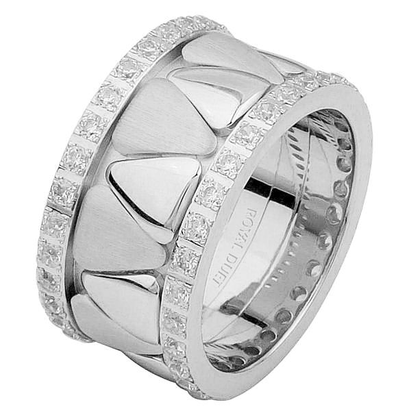 Item # 68746010DWE - 18 kt white gold, comfort fit, 11.1 mm wide, diamond eternity ring. The band is made of white gold with rounded triangles in the center. The diamonds go around the whole ring. It has approximately 1.05 ct tw round briliant cut diamonds, that are VS1-2 in clarity and G-H in color. Diamond total weight may vary slightly depending on the size of the ring.