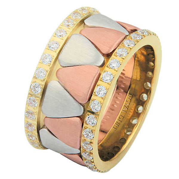 Item # 68746120DE - 18 kt tri-color, comfort fit, 11.1 mm wide, diamond eternity ring. The band is made beautifully with white, rose and yellow gold. The shapes in the center are rounded triangles. The diamonds accenting each side complete the diamond eternity look. It has approximately 1.05 ct tw round brilliant cut diamonds, that are VS1-2 in clarity and G-H in color. Diamond total weight may vary depending on the size of the ring.