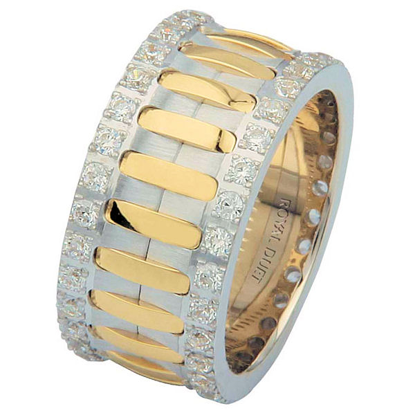 Item # 6874801D - 14 kt two-tone gold, comfort fit, 10.1 mm wide, diamond eternity ring. The band has a beautiful composition of white and yellow gold with diamonds accenting each side of the ring. It has approximately 1.05 ct tw round brilliant cut diamonds, that are VS1-2 in clarity and G- H in color. Diamond total weight may vary depending on the size of the ring.