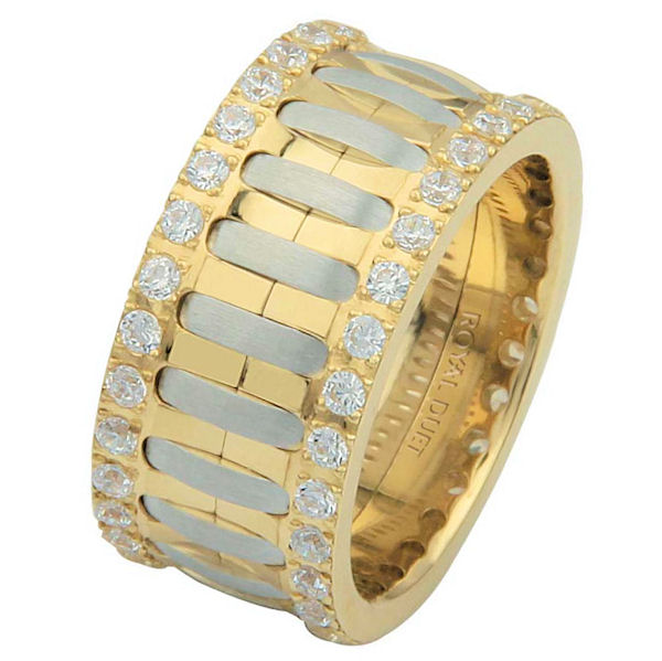 Item # 6874810DE - 18 kt two-tone gold, comfort fit, 10.1 mm wide, diamond eternity ring. The band has a beautiful composition of white and yellow gold with diamonds accenting each side of the ring. It has approximately 1.05 ct tw round brilliant cut diamonds, that are VS1-2 in clarity and G- H in color. Diamond total weight may vary depending on the size of the ring.