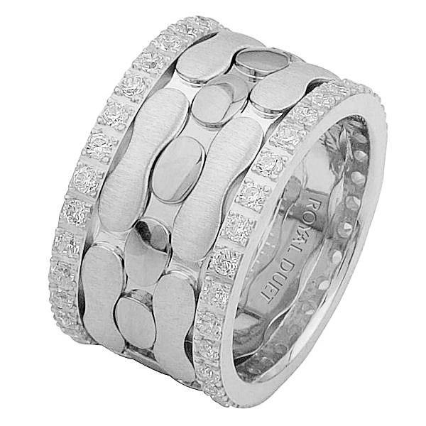 Item # 68749102DWE - 18 kt white gold, comfort fit, 12.0 mm wide, diamond eternity ring. The band has a unique design made with white gold with diamonds accenting the ring on each side. It has approximately 1.05 ct tw round brilliant cut diamonds, that are VS1-2 in clarity and G-H in color. Diamond total weight may vary depending on the size of the ring.