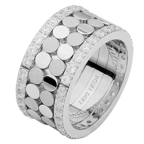 Item # 68750102DWE - 18 kt white gold, comfort fit, 10.35 mm wide, diamond eternity ring. The band has a unique design made with white gold and diamonds accenting each side of the ring. It has approximately 1.05 ct tw round brilliant cut diamonds, that are VS1-2 in clarity and G-H in color. Diamond total weight may vary depending on the size of the ring.