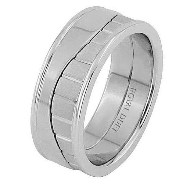 Item # 68752010WE - 18 kt white gold, comfort fit, 8.25 mm wide, wedding ring. The band has a unique design made with white gold. There is a mix of brushed and polished finishes. Other finishes may be selected or specified.