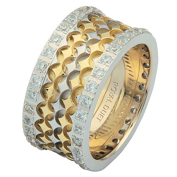 Item # 68753010DE - 18 kt two-tone gold, comfort fit, 10.0 mm wide, diamond eternity ring. The band has a beautiful composition of white and yellow gold with diamond accenting each side of the band. It has about 1.05 ct tw round brilliant cut diamonds, that are VS1-2 in clarity and G-H in color. The total diamond weight may vary depending on the size of the ring.