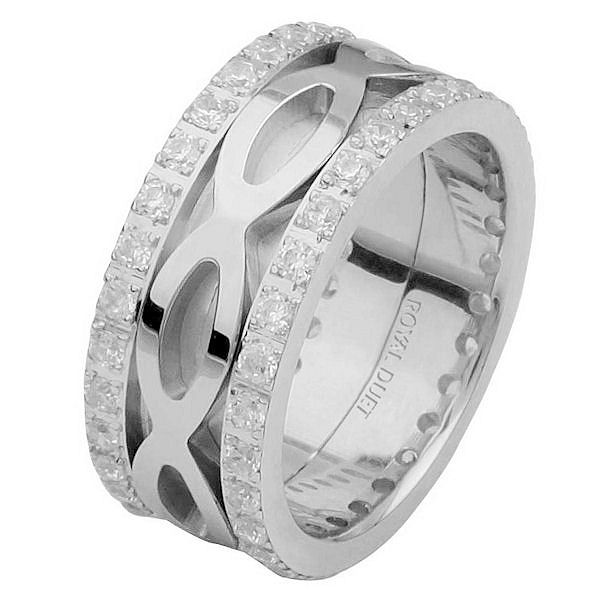 Item # 6875610DWE - 18 kt white gold, comfort fit, 8.75 mm wide, diamond eternity ring. The band has a unique design made with white gold and diamonds accenting each side of the ring. It has about 1.05 ct tw round brilliant cut diamonds, that are VS1-2 in clarity and G-H in color. The diamond total weight may vary depending on the size of the ring.