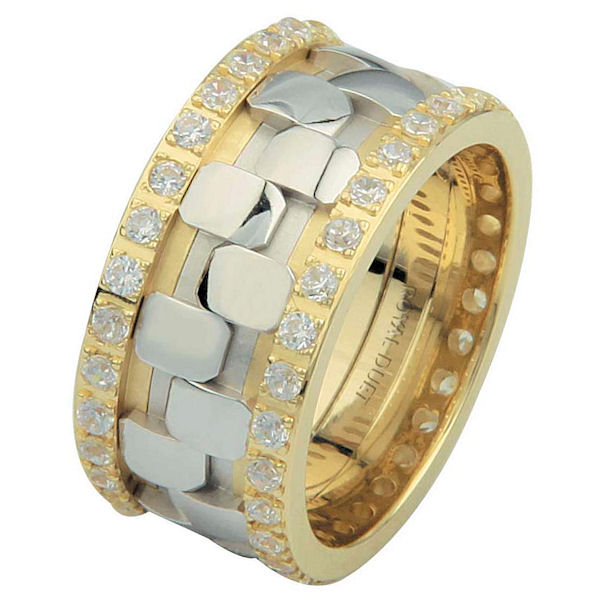 Item # 6875710D - 14 kt two-tone gold, comfort fit, 10.15 mm wide, diamond eternity ring. The band has a beautiful combination of white and yellow gold with diamonds accenting each side of the ring. It has about 1.05 ct tw round brilliant cut diamonds, that are VS1-2 in clarity and G-H in color. The total weight of the diamonds may vary depending on the size of the ring.