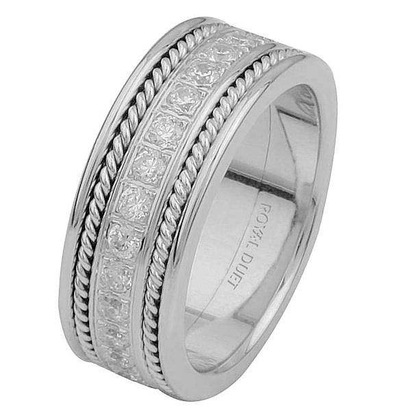 Item # 6875810DWE - 18 kt white gold, comfort fit, 7.65 mm wide, diamond eternity ring. The band has a beautiful hand crafted design made with white gold and diamonds set down the center of the ring. It has about 1.02 ct tw round brilliant cut diamonds, that are VS1-2 in clarity and G-H in color.